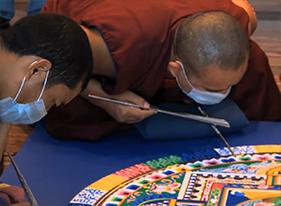 Buddhist monks create a sand mandala in Houston